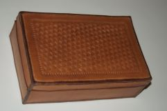 Leather box with mitered and hand-sewn edges.