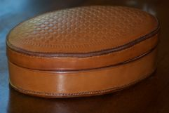 Oval box. Hermann Oak leather was first worked over a wooden form and then sewn.