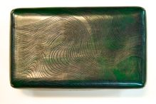 Green box with wave design.
