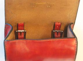 Inside of 2 strap red bag.