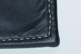 detail of hand stitching on kangaroo wallet