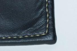 detail of hand stitching on kangaroo wallet