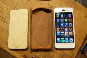 iPhone 5 with case and wooden form.