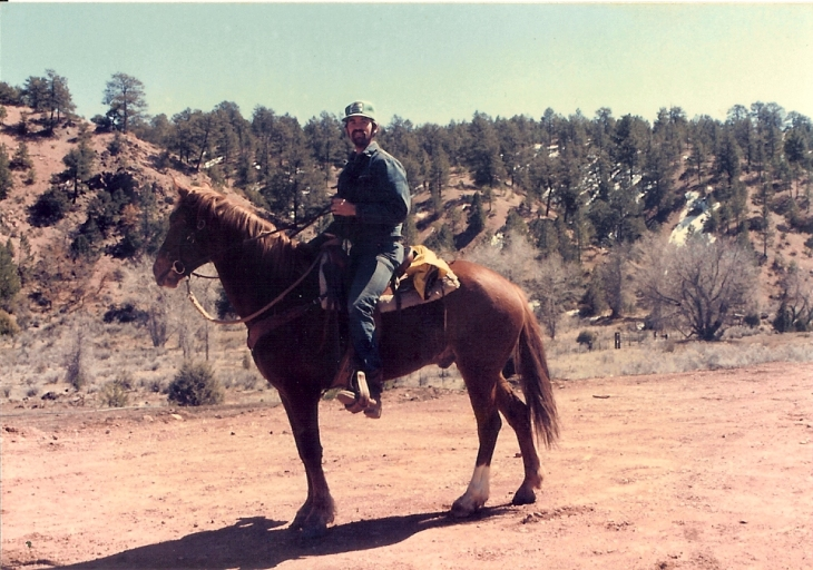 Riding my horse, Logan (aka Psycho) with the saddle I made in Apache Canyon while working as a caretaker.