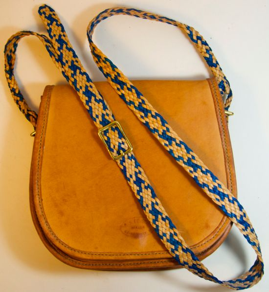 Small purse made from kangaroo leather with braided strap. The braiding for this bag has roots in Australia.