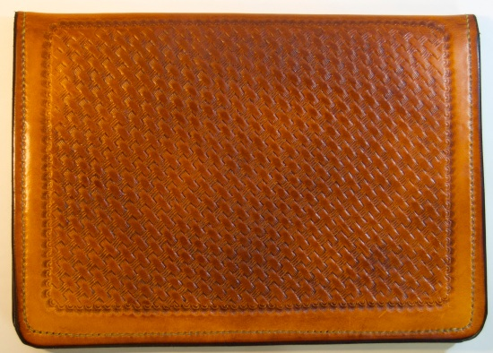 Front of iPad_Air case with basket stamping. All hand made.
