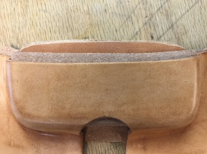 Start by forming the leather over a wooden form