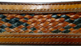 Detail of belt with inlaid 14 strand braid of kangaroo lace.